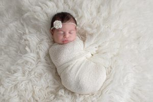 A sleeping baby with a warm and comfortable British sheepskin